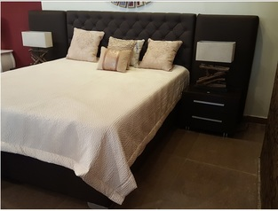 Chocolate brown leather bedframe.index
