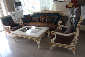 buy Blue & Brown Italian sofa set (8 sitters, 2 side stools & center table)